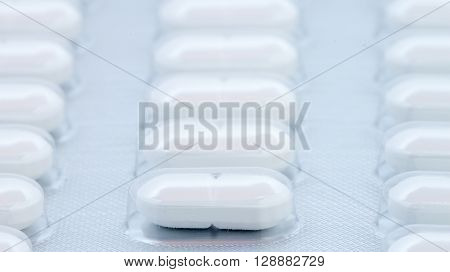 white pills in blister pack can be used as background