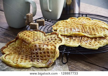 Freshly baked waffles on a cooling rack