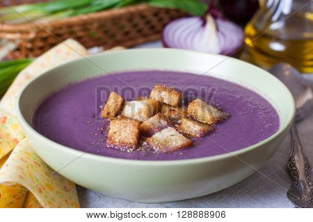 Cream soup of cabbage and croutons in a bowl