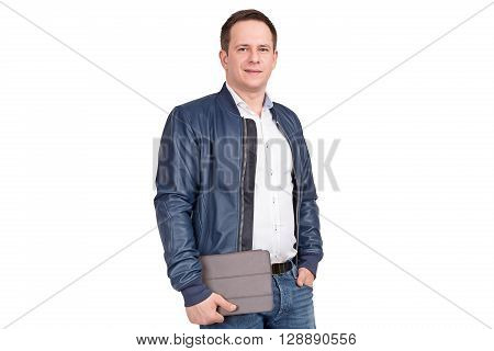 Handsome European Male In Blue Leather Jacket With Tablet Pc In His Hands Isolated On White Backgrou
