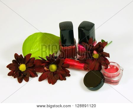 Nail polish rouge and glitter lipstick, beauty care
