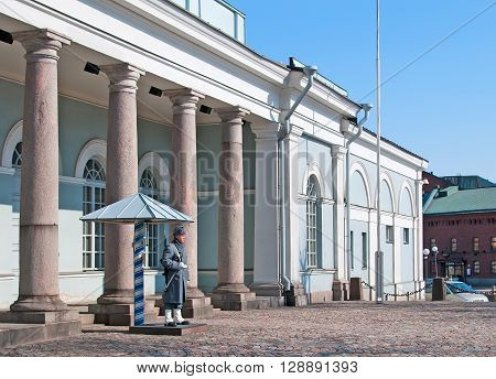 HELSINKI, FINLAND - APRIL 10, 2010: Guard soldier stands near The Main Guard Building in the center of Helsinki not far from The Presidential palace