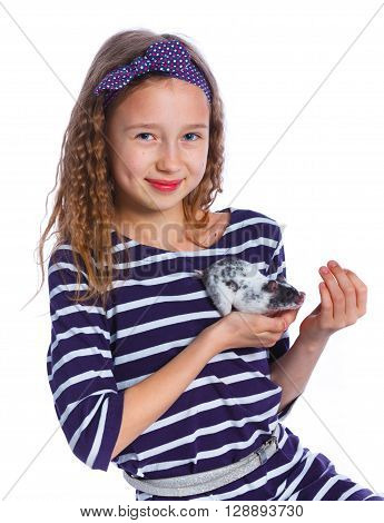 Cute girl holding a hamster. Isolated on white background.