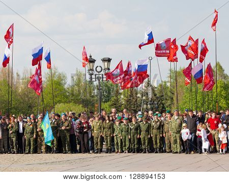 Moscow - May 6 2016: People and combat veterans patriotic action carried out under the flags of Russia and the military brotherhood in Victory Park May 6 2016 Moscow Russia