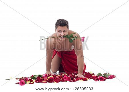 Smiling macho man posing with rose in his mouth. Isolated on white