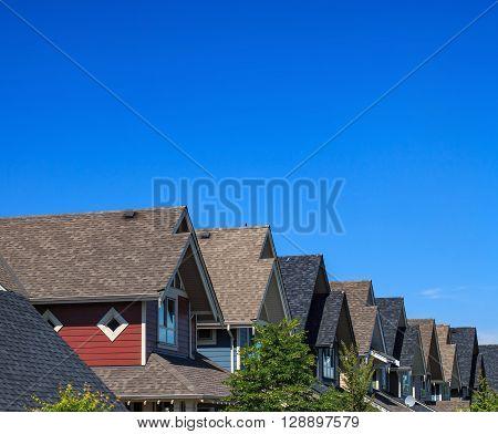Modern residential buildings against blue sky in North America.