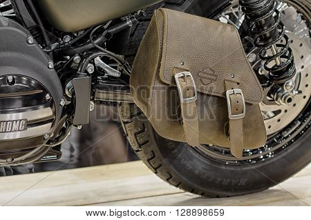BRNO CZECH REPUBLIC-MARCH 4, 2016: Close-up of leather single-sided svingarm bag of motorcycle Harley Davidson Softail Slim S on International Fair for Motorcycles on March 4, 2016 in Brno in Czech Republic