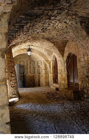 This old stone arcade you have to go to get to the church in a small village in France