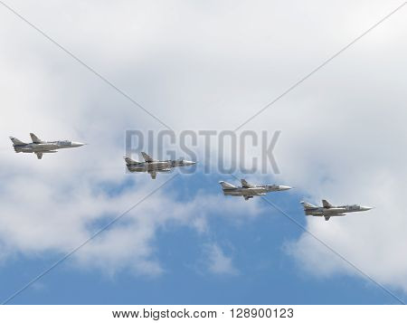 Moscow - May 7 2016: four front-line bomber with variable sweep wing Su-24 flying in the sky over Red Square on May 7 2016 Moscow Russia