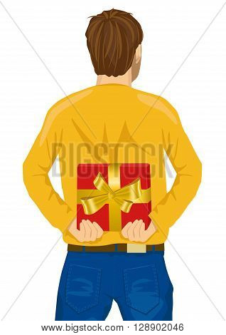 young man hiding gift behind his back isolated over white background
