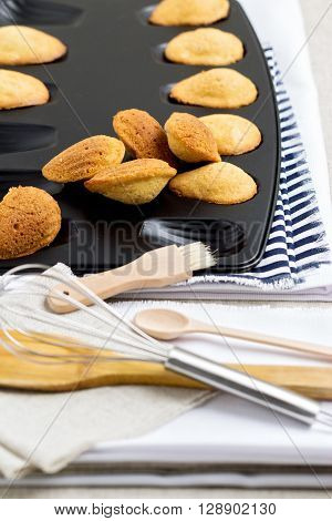 French cookies madeleines in the shape of a shell. Selective focus.