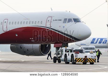 Airplane Red Wings Airlines Operate Towing