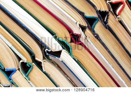 old damaged books diagonal multicolored background, horizontal