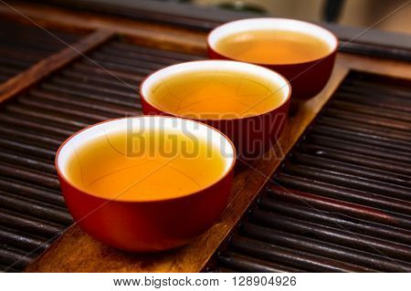 Chinese tea on wood plate background and rice paper