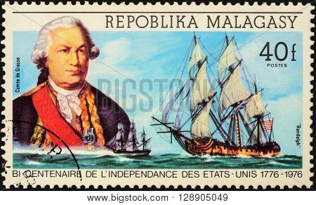 MOSCOW RUSSIA - MAY 06 2016: A stamp printed in Malagasy shows French admiral comte de Grasse and ship
