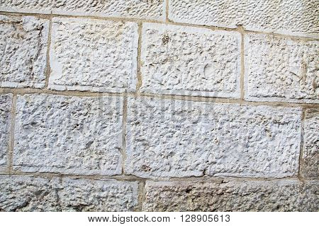 Close-up of an old historic weathered wall inside Old Jerusalem, Israel.