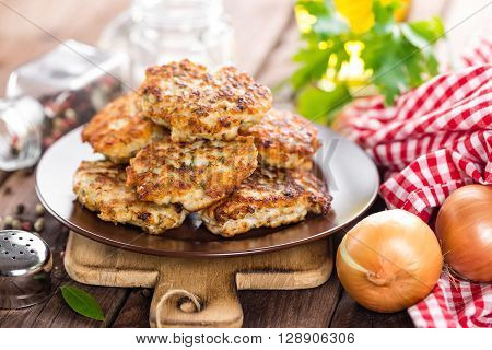 fried meat cutlets on a plate on table