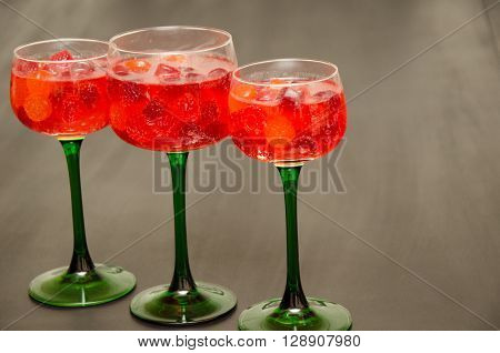 Trio of Green Stemmed Wine glasses with Colorful Candy and Juice