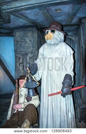 LONDON UK - JUNE 7 2015: Wax figures depicting the situation in London during the plague at one of halls of historical part of Madame Tussauds museum. Madame Tussauds London is famous for recreating famous people and celebrities in wax. It is located in t