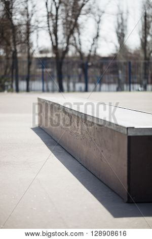 Ledge for doing tricks grinding in outdoor skate park. Obstacle made for skateboarding roller blading bmx riding and other extreme sports.