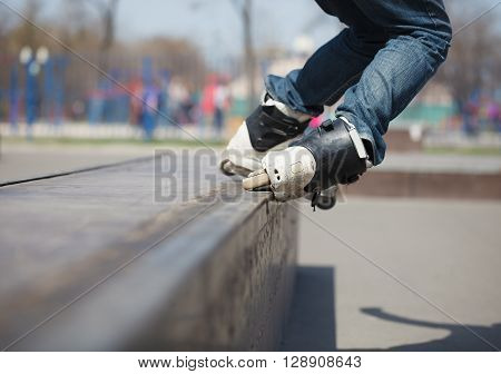 Rollerblader Grinding Topsoul Trick On A Ledge In Skatepark