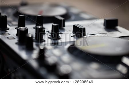 Professional audio mixing technology for disc jockey. Modern device for playing music from notebook or flash drive on any event. No DJ on photo.