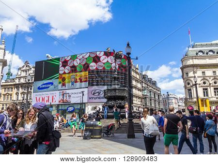 LONDON UK - JUNE 7 2015: Unidentified tourists at  Piccadilly Circus road junction built in 1819 famous tourist attraction links to West End Regent Street Haymarket Leicester Square
