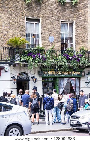 LONDON UK - JUNE 6 2015^ Unidentified tourists near  Sherlock Holmes house and museum in 221b Baker Street. Here is where Arthur Conan Doyle located the studio of the famous detective.