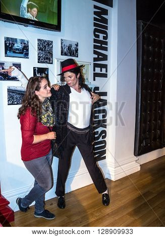 LONDON UK - JUNE 7 2015: Unidentified tourist near Michael Jackson the singer Madame Tussauds museum. Marie Tussaud was born as Marie Grosholtz in 1761