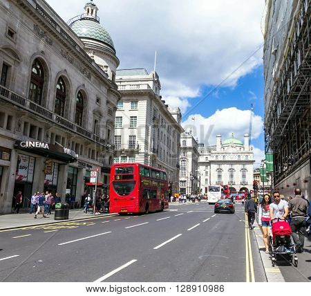 LONDON UK - JUNE 7 2015:Unidentified people at  Regent's street . It was named after Prince Regent completed in 1825. Every building in Regent Street is protected as a Listed Building.