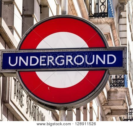 LONDON UK - JUNE 7 2015: Tube sign on the wall of the building