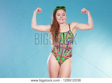 Strong Woman Girl In Swimsuit Showing Off Muscles.