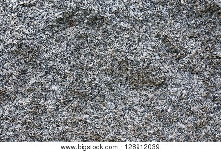 Texture of gray unprocessed rough granite closeup
