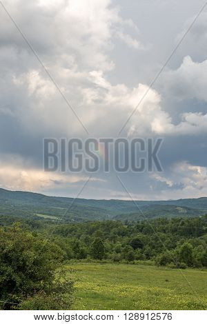 Nature hilly landscape and dramatic cloudy sky