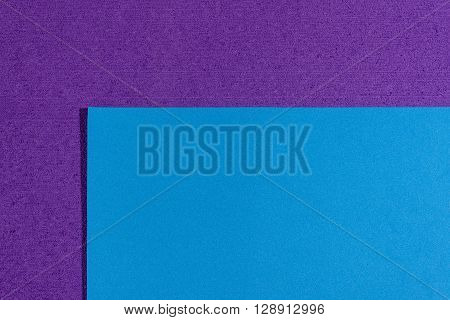 Eva foam ethylene vinyl acetate smooth blue surface on purple sponge plush background
