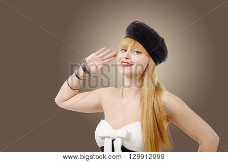 A cute pin up girl giving a salute.