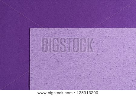 Eva foam ethylene vinyl acetate sponge plush light purple surface on purple smooth background
