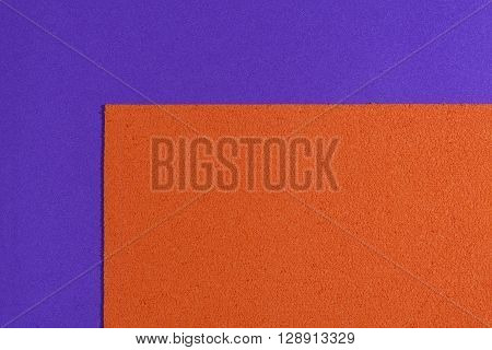 Eva foam ethylene vinyl acetate sponge plush orange surface on purple smooth background
