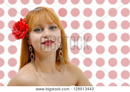 A beautiful young spanish woman is posing