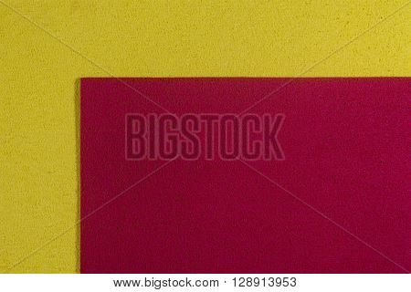Eva foam ethylene vinyl acetate red surface on lemon yellow sponge plush background