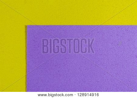Eva foam ethylene vinyl acetate light purple surface on lemon yellow sponge plush background