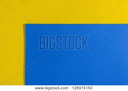 Eva foam ethylene vinyl acetate smooth blue surface on lemon yellow sponge plush background