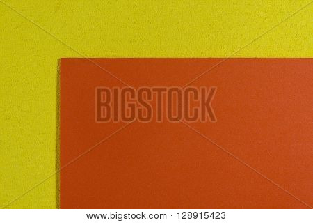 Eva foam ethylene vinyl acetate smooth orange surface on lemon yellow sponge plush background
