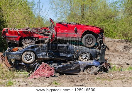 GRIMMEN / GERMANY - MAY 5: three destroyed cars lying on a pile on may,5 2016 in grimmen / germany