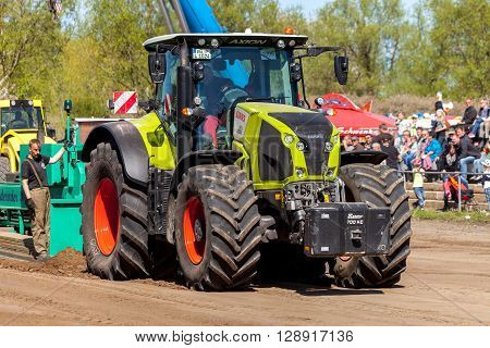 GRIMMEN/ GERMANY - MAY 5: german claas axion tractor drives on track by a traktor pulling event on may 5 2016 in grimmen / Germany.
