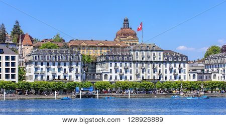 Lucerne, Switzerland - 8 May, 2016: view on the Schweizerhofquai quay over Lake Lucerne with the Hotel Schweizerhof building. Lucerne is a city in central Switzerland it is the capital of the Swiss Canton of Lucerne.