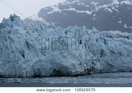 Glacier over the Bay with Mountains in the Background