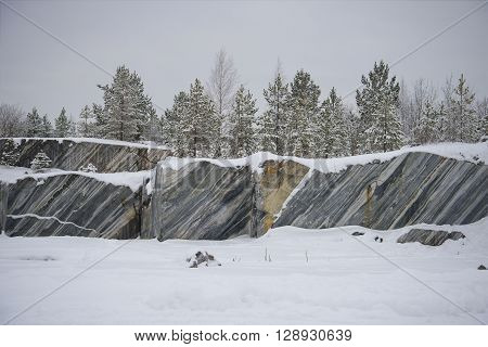 Marble cliff quarry in Ruskeala gloomy january afternoon. Karelia, Russia