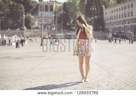 Young Woman Talking At Mobile Phone In Rome Place Piazza Del Popolo