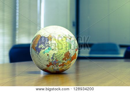 world globe sitting on a desk.vintage world globe.